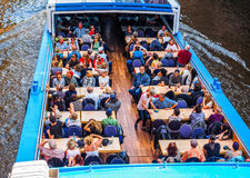 Boat in Hamburg port hdr. HAMBURG, GERMANY - CIRCA MAY 2017: Boat in HafenCity canal in Hamburg port, hdr Stock Images