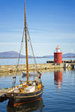 Boat in Harbor,  Alesund, Norway Royalty Free Stock Photos