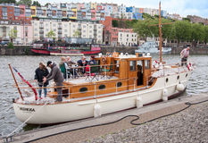 Boat in harbor with on board party. In bristol,uk, people talking and drinking wine Royalty Free Stock Image