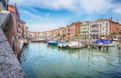 Boat harbor - Canale Grande, Venice, Italy. Some buildings, boats, blue water. Nice travel shot in Venice royalty free stock photo