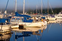 Boat harbor in foggy morning Royalty Free Stock Photo