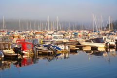 Boat harbor in foggy morning Royalty Free Stock Image