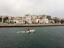 Boat in harbour of Bosporus. royalty free stock photography