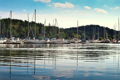 Boat harbour in summer, swedish archipelago setting. Boat harbour with sailboats and beautiful lights royalty free stock photo