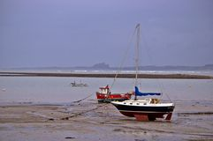 Boat in a harbour with tide out Stock Image