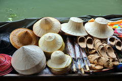 Boat with hats on floating market in Bangkok Royalty Free Stock Photo