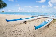 Boat on Hawaiian beach. A wooden boat on the shore of a peaceful and quiet Hawaiian beach Stock Photo