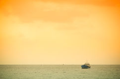 Boat heading out to the ocean Stock Photography