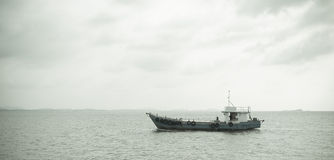 Boat heading out to the ocean in the early morning. Fishing boat heading out to the ocean in the early morning Stock Photos