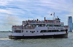 Boat heading out to the Statue of Liberty Royalty Free Stock Image