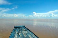 A boat heading to horizon Stock Photos