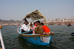 Boat with the hindu pilgrims sails at the Ganges Royalty Free Stock Image