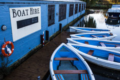 Boat Hire. Boats for hire on a river bank royalty free stock photography