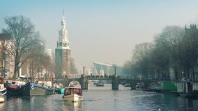 Boat On Historic Canal Through City stock footage