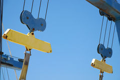 Boat Hoists. Yellow and blue boat hoists for dry docking boats and yachts against blue sky Royalty Free Stock Photos