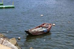 Boat. Hong Kong  July 2016 - A small boat moored off the bank on Cheung Chau Island in Hong Kong Royalty Free Stock Image