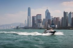 Boat in Honkong city. The boat swims in hongkong bay Royalty Free Stock Images