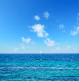 Boat at the horizon with fata morgana effect Stock Image