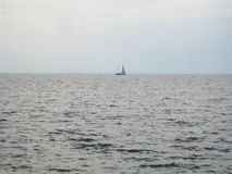 Boat. A boat on the horizont of the black sea, black water, grey sky, rainy weather, no sunshine Royalty Free Stock Images