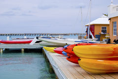 Boat house. Many colorful kayaks on boat house deck Stock Photo