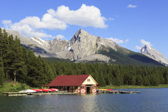 Boat house on an alpine lake in Canadian Rockies Royalty Free Stock Photography