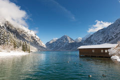 Boat house in austrian lake at snowy Royalty Free Stock Photo