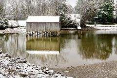 Boat House Covered in Snow. During winter snowstorm on a lake Royalty Free Stock Photography