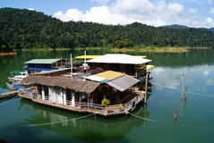 Boat House by the Lake. Landscape scene of lake, mountains and virgin forest at Titiwangsa, Malaysia Royalty Free Stock Photos