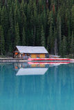 Boat house in lake louise stock images