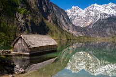 Boat house on lake Obersee with beautiful reflections Stock Photo