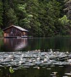 Boat house on lake Stock Photo