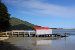 Boat house with red roof,. Otago Peninsula, dunedin, south island, new zealand Royalty Free Stock Images