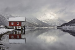 Boat house reflection in the Norwegian fjords Stock Photo