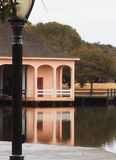 Boat house reflections. Built as a private hunting lodge in 1922, the Whalehead club in the Outer Banks of North Carolina is still celebrated and in use today Stock Photos