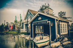 Boat House beside the river in grunge style Royalty Free Stock Photos