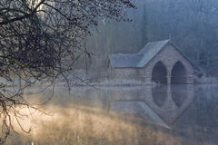 Boat house at sunrise. Old boat house pictured at sunrise stock photo