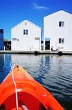 Boat house in Tacoma, WA and orange kayak. Royalty Free Stock Images