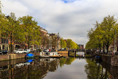Boat and houseboat on the canal in Amsterdam royalty free stock image