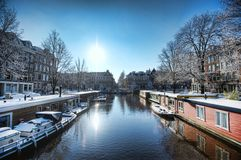 Boat Houses in Amsterdam. Boat houses lining a river in Amsterdam Royalty Free Stock Images