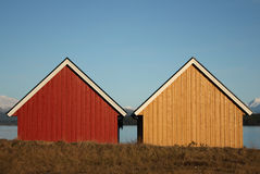 Boat houses in the evening. Two red and yellow boat houses in the evening sun Stock Photos