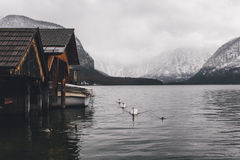 Boat houses on glacial lake Stock Photos
