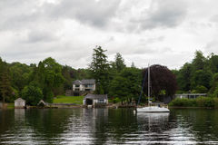 Boat and houses on Lake Windermere lake-shore Royalty Free Stock Photo
