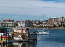 Boat houses and sailboat at Fisherman wharf royalty free stock photo