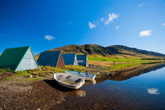 Boat houses by still mountain lake Stock Image