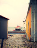 Boat between houses Royalty Free Stock Photos