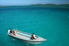 Boat Hover On Turquoise Blue Ocean Royalty Free Stock Image