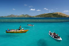 Boat hover on turquoise blue ocean Stock Photos