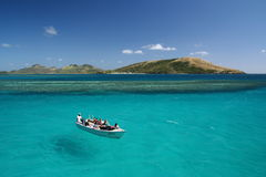Boat hover on turquoise blue ocean Royalty Free Stock Photography