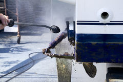 Boat hull cleaning water pressure washer. Barnacles antifouling and seaweed Stock Photos
