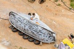 Boat hull sanding Royalty Free Stock Photo